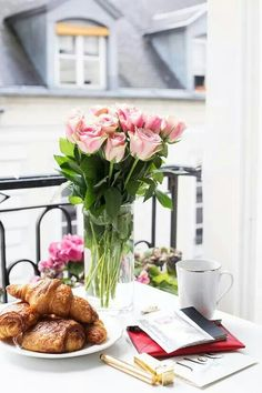 Perfect Setting With Fresh Roses Croissants And Coffee