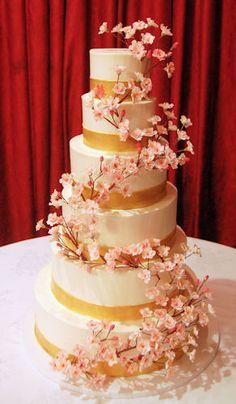 Buttercream wedding cake with sugar cherry blossoms.