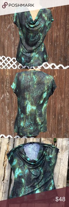 Kenneth Cole Reaction Scoop Neck Top Snake Print Kenneth Cole Reaction Top! Super cute green snake skin pattern! Neck hangs low, I believe it's called a scoop neck. (Please, correct me if I'm wrong😅)! Comment if you have any questions!  Like this listing to be offered a great deal! Check out the rest of my closet and see all of my bundle discounts! Thanks for viewing! Kenneth Cole Reaction Tops Blouses