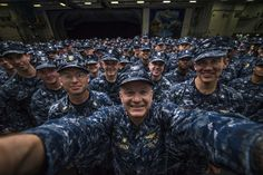 PACIFIC OCEAN (May 30, 2014) Capt. Greg Fenton, commanding officer of the U.S. Navy's forward-deployed aircraft carrier USS George Washington (CVN 73), center, takes a selfie with Capt. Carlos Sardiello, George Washington's executive officer, right, George Washington's Command Master Chief Shaun Brahmsteadt and 275 newly frocked petty officers after a command frocking ceremony in the ship's hangar bay. (U.S. Navy photo by Capt. Greg Fenton/Released)