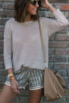 I love interesting shorts. Also like the casual sweater. Not a huge fan of the studs on the bag but I like the shape of it.