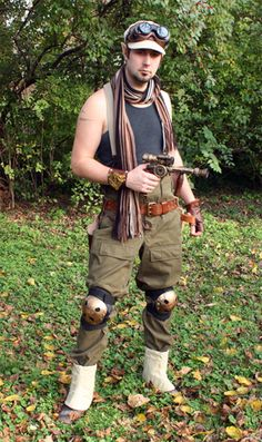 Steampunk Airship Mechanic knee protection, spats, khaki cargo pants, two inch wide leather belt, goggles, brown leather glove, hat, suspenders, steampunk gun,
