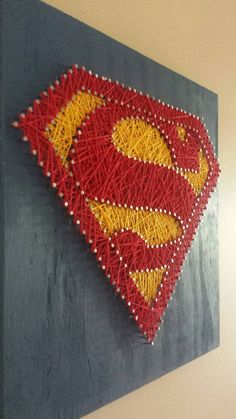 [[ String art patterns are easy enough to find, and something this simple you don't need instructions to string it! ]] Superman String Art Wall Art by henriettabloomfield on Etsy