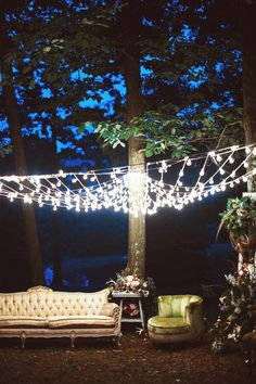 Outdoor, Vintage Lounge Area with String Light Canopy | Photography: Veronica Varos Photography. Read More: http://www.insideweddings.com/weddings/a-bohemian-inspired-wedding-shoot-in-an-enchanted-forest/643/