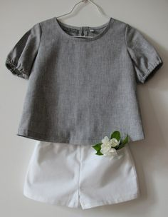 A pretty close knockoff for this would be a grey 2+2 blouse with white puppet show shorts both O+S