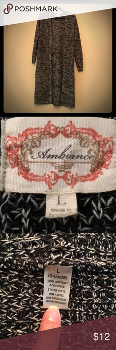 """Black and white sweater Black and white acrylic sweater. Great condition and perfect for pairing with jeans when you need a light sweater. Approximately 17"""" across shoulders, 43"""" long and 21 pit to pit. Sleeves are approximately 26"""" long but can be pushed up on the arm. Ambiance Apparel Sweaters"""