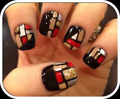 black polish base with red, silver and gold geometric details nail art design