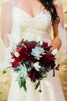 Bouquet by A Touch of Lavender. Burgundy dahlias, succulents, blue thistles, and eucalyptus.