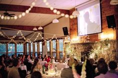 We will be using a projector screen in the reception area while we're taking pictures after the ceremony. I like how the screen is up higher. And everybody seems to be enjoying it!!
