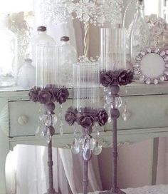 dollar tree vases, hand made flowers, stair spindle from Lowe's and left over chandelier parts! Oh yeah, i could make these!! Love E6000 glue!!!