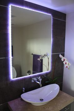 Beautiful use of LED lights around this mirror. LED stripe lighting is very energy efficient
