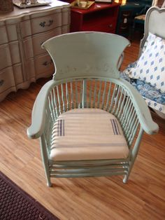 This chair was painted in duck egg blue and then the seat was reupholstered in remnant feedsacks.