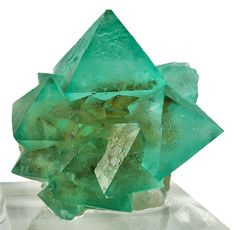 a matrix of drusy quartz intergrown cluster of octahedral, lustrous and gemmy, richly emerald-green fluorite crystals / Mineral Friends Crystals Minerals, Rocks And Minerals, Crystals And Gemstones, Stones And Crystals, Cool Rocks, Mineral Stone, Rocks And Gems, Fossils, Emerald Green