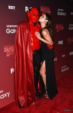 Lea Michele poses with the red devil