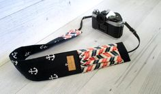 Padded Camera Strap Cover. Navy Anchor DSLR Camera Strap Cover with Coral Lens Pockets. Canon or Nikon Camera Strap. Gift for Photographer. by JanieLaneStudio on Etsy https://www.etsy.com/listing/245043002/padded-camera-strap-cover-navy-anchor