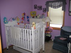 Adorable nursery with navy blue walls! Perfect for a baby boy!