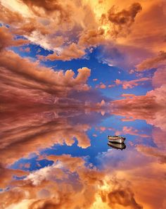 Photographer captures water reflecting sky and sunset at the perfect angle for an eternal reflection.
