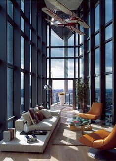 Contemporary space with a great airplane displayed above.