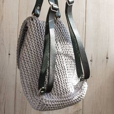 Gray knitted cotton backpack. Details: height 32cm, Width 27cm 100% cotton Weight 700gr Leather handles Production time 7-14 days Recommendations for care: - Manual or delicate wash