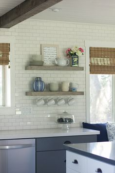 I like the idea of a couple of semi-decorative shelves in the kitchen with mugs hanging from the bottom shelf.