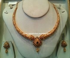 This beautiful antique finished 22 karat gold necklace in nakshi workmanship with intricate design on a thick gold base with matching earrings sri maha Jewelry Design Earrings, Gold Earrings Designs, Gold Jewellery Design, Gold Jewelry, Indian Gold Necklace Designs, Gold Designs, Gold Necklaces, Diy Jewellery, Jewellery Storage