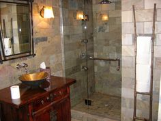 The rich and earthy texture of this slate tile enhances the exotic style of this bathroom.