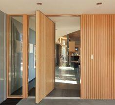 Pivot wood door...strange choice for threshold finish.