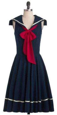 Sea Shanty Singing Dress in Navy As you climb aboard the three-mast ship, the wind ruffles the full hem of your dress - this sailor-inspired piece whose navy-blue hue is exclusive to ModCloth. Once on deck, you straighten this frock's deliciously cute ruby neck tie, and head toward the sound of the music. Entering the ship's main hall in this dress, wicker-soled wedges, shining post earrings, and several dainty rings, you draw admiring stares from more than a few in the assembled crowd.