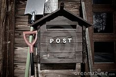 Wooden letterbox by Photogerson, via Dreamstime