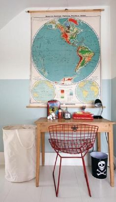vintage globes in living room | Vintage school map used to decorate a kids room.