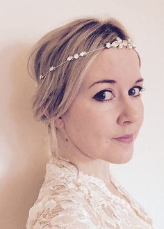 Beautifully sparkly, simple, elegant Swarovski crystal bridal/bridesmaid headpiece. Perfect around the forehead or in the hair. Satin ribbon ties at the back allow adjustment to fit any head size. Also available in gold: