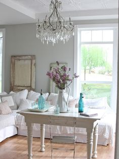 Shabby Chic Living Room...the couches look like 2 twin beds...I like this idea..repurpose some old day beds?