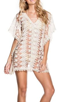 90b5fd8f100 Embroidered sheer ivory poncho from Onda de Mar features a v-neck and lace  trimmed