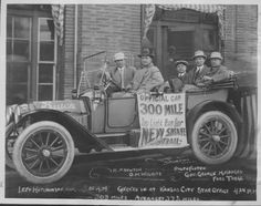 This black and white photograph shows one of three Buick cars, used during the 300 mile race over the new Santa Fe Trail, in front of the Kansas City Star newspaper office.  The three automobiles left from the Hutchinson News office at 5:01 a.m. and arrived at the Kansas City Star office at 4:24 p.m to prove that a 300 mile automobile trip could be made on Kansas dirt highways in twelve hours