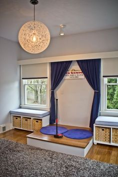 Kids love a stage to play on and this one is perfect for a kids' playroom - complete with curtains and microphone!