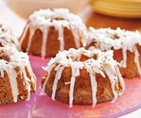 Toasted coconut flakes and coconut milk are used in these mini cakes, which are topped with a light glaze.