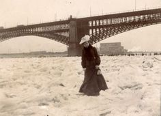 """The Mississippi River frozen 'solid', February 1905"". Woman crossing frozen river during Ice Gorge of 1905. Missouri History Museum."