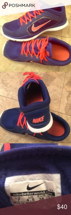 Orange & Blue Women's Nike Shoes Bright orange and blue women's athletic shoes. Excellent used condition. Size 7 US Nike Shoes Athletic Shoes