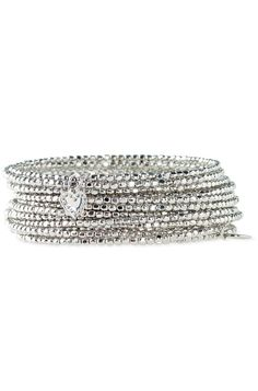 Bardot Spiral Bangle in Silver by Stella & Dot. A metallic coil of silver plated nuggets gives the look of stacked bangles (without the noise!). Finished off with our tiny signature heart.