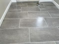 Confer A Long Lasting Touch Of Ceramic Like Style To Your Home Decor Using  This TrafficMASTER Ceramica Coastal Grey Vinyl Tile Flooring.