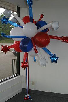 http://www.balloonsculptures.com/images/STARBURST_TOPIARY_lg.jpg