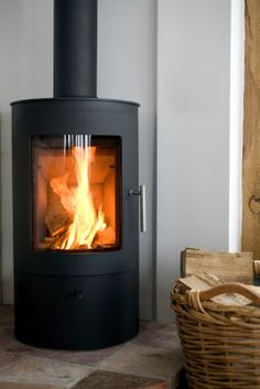 Photo about Modern Wood burning stove in modern interior. Image of indoors, decor, contemporary - 28781787 Wood, Furniture Design Modern, Home, Contemporary Bedroom Furniture, House Heating, Home Heating Systems, Energy Efficient Homes, Stove, Wood Burning Stove
