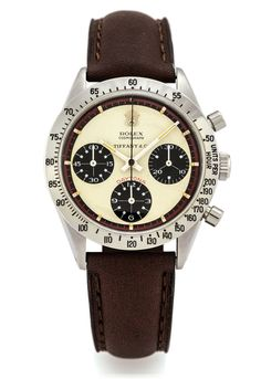 ROLEX REF. 6239 PAUL NEWMAN RETAILED BY TIFFANY Rolex, Cosmograph Daytona, retailed by Tiffany, case No. 2011295, Ref. 6239. Made in 1969.