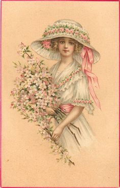 pretty girl in white/pink outfit & large hat, holds armful of blossom, facing left, looking front