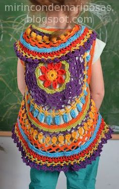 A beautiful crochet mandala vest with a free pattern and video tutorial! We've also got some great crochet mandala inspiration for you here! Diy Crochet Cardigan, Crochet Circle Vest, Crochet Circles, Crochet Jacket, Crochet Mandala, Crochet Shawl, Knit Crochet, Crochet Paisley, Mode Crochet