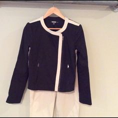 DKNY black and cream blazer - fits like an 8 Lightweight spring blazer with asymmetrical zipper and trim, plus vertical zip pockets.  Size 10 but may fit an 8 if you have broad shoulders. 64% ramie / 32% viscose / 4% elastase DKNY Jackets & Coats Blazers
