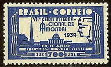 During the 1930s, Brazil issued a number of stamps influenced by the Art Deco style, especially in their lettering.[16] The most striking Art Deco stamps, however, was the 1934 issue commemorating the 7th International Trade Fair, held in Rio de Janeiro, and depicting silhouettes of buildings and a profile of a construction worker with highly stylized Art Deco lettering.