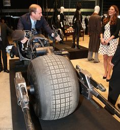 Where's the start button? Prince William asked as he was delighted to sit on the 'Bat Bike' from the film The Dark Knight Rises. April 26, 2013