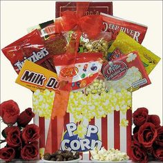 Gourmet Movies Gift Basket Where there is popcorn there must be movies and this basket has them both. This adorable gift basket is the perfect choice for a romantic evening for two. This basket featur