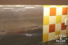 Turning a Tile Backsplash into a Stainless Steel Backsplash with Contact Paper